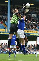 Photo: Jo Caird<br /> Fulham v Leicester<br /> Loftus Rd<br /> Barclaycard Premiership 2003<br /> 04/10/2003.<br /> <br /> Edwin Van Der Sar (Goalie) vs Gerry Taggart of Leicester