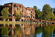 The Lodge at Whitefish Lake Resort reflects in Whitefish Lake in Montana