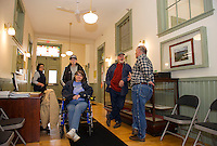 Maria Ogni, Cindy Haskell, Carol Power, Wayne Ogni and Steve McCormack in the main entry hall of the Gilmanton Academy building during their open house on Saturday.  (Karen Bobotas/for the Laconia Daily Sun)