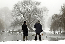 © under license to London News Pictures 06.12.2010 Two elderly men at Footscray Lake, Kent, today (Mon).  Forecasters say Britain's 'Big freeze' is set to continue throughout The week. Picture credit should read Grant Falvey/London News Pictures.