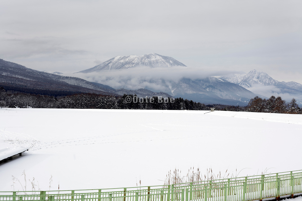 winter mountain with frozen lake and snow landscape Japan Nagano prefecture