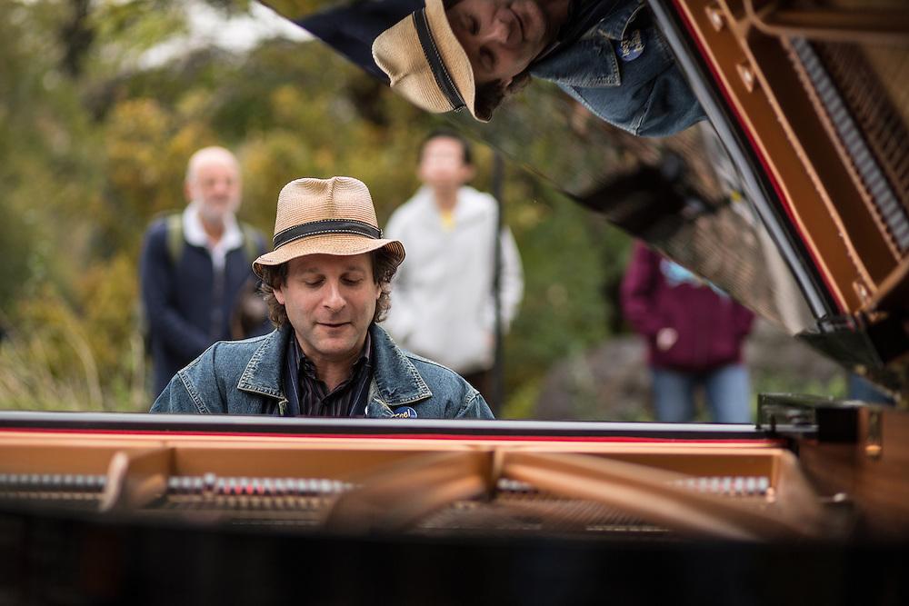 Eli Yamin reflected in the piano.