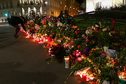 14.11.2015, Botschaft der Französischen Republik, Wien, AUT, Terroranschläge von Paris, Gedenken in Österreich, im Bild ein Mädchen bei den Kerzen und Blumen vor der Botschaft. Bei einer Serie von Terroranschlägen in Paris wurden mindestens 128 Menschen getötet. Terroristen hatten in der Nacht bei Angriffen mit Schusswaffen und Bombenanschlägen gezielt Anschläge auf Frankreich verübt // A girl with the candles and flowers in front of the embassy. French President Francois Hollande said more than 120 people died Friday night in shootings at Paris cafes, suicide bombings near France national stadium and a hostage- taking slaughter inside a concert hall, at the French embassy in Vienna, Austria, EXPA Pictures © 2015, PhotoCredit: EXPA/ Sebastian Pucher