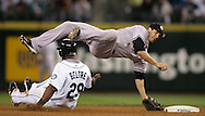 Seattle Mariners' Adrian Beltre is forced out at second but breaks up a double play attempt scoring a run as New York Yankees second baseman Nick Green tumbles. (AP Photo/John Froschauer)