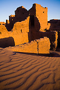 The crumbling walls of Ait Bounou, an ancient kasbah, or fortified village, in the Moroccan Sahara. The town is quickly falling into ruin as the inhabitants flee the drying well and the advancement of the dunes expedited by a 16-year drought and the damming of the Draa River.