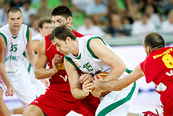 Erazem Lorbek of Slovenia between Nikola Vucevic of Montenegro and Milos Borisov of Montenegro during friendly basketball match between National teams of Slovenia and Montenegro of Adecco Ex-Yu Cup 2011 as part of exhibition games before European Championship Lithuania 2011, on August 7, 2011, in Arena Stozice, Ljubljana, Slovenia. Slovenia defeated Crna Gora 86-79. (Photo by Vid Ponikvar / Sportida)