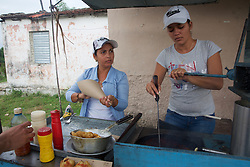 Woman Making Food At Roadside Food Cart