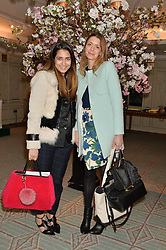 Left to right, NORA KHAN and LUCY DAY at the launch of Mrs Alice in Her Palace - a fashion retail website, held at Fortnum & Mason, Piccadilly, London on 27th March 2014.