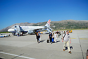 Passengers disembarking onto tarmac, Dubrovnik Airport, Dubrovnik, Croatia.