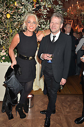 AMANDA ELIASCH and TIM WILLIS at a party to celebrate 35 years of Harry's Bar, 26 South Audley Street, London on 19th September 2014.