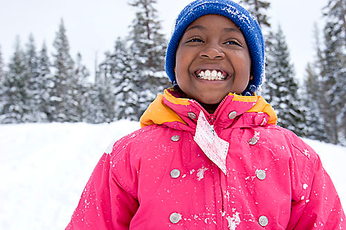 Young girl playing in snow at Kirkwood ski resort near Lake Tahoe, CA.