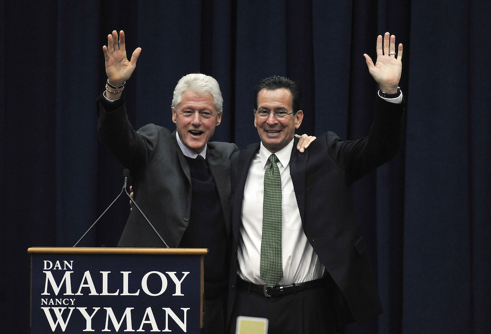 Former President Bill Clinton, left, campaigns for Democratic candidate for governor Dan Malloy, right, at a rally at the University of Hartford in West Hartford, Conn., Saturday, Oct. 31, 2010. Malloy faces Republican Tom Foley in the Nov. 2 election. (AP Photo/Jessica Hill)