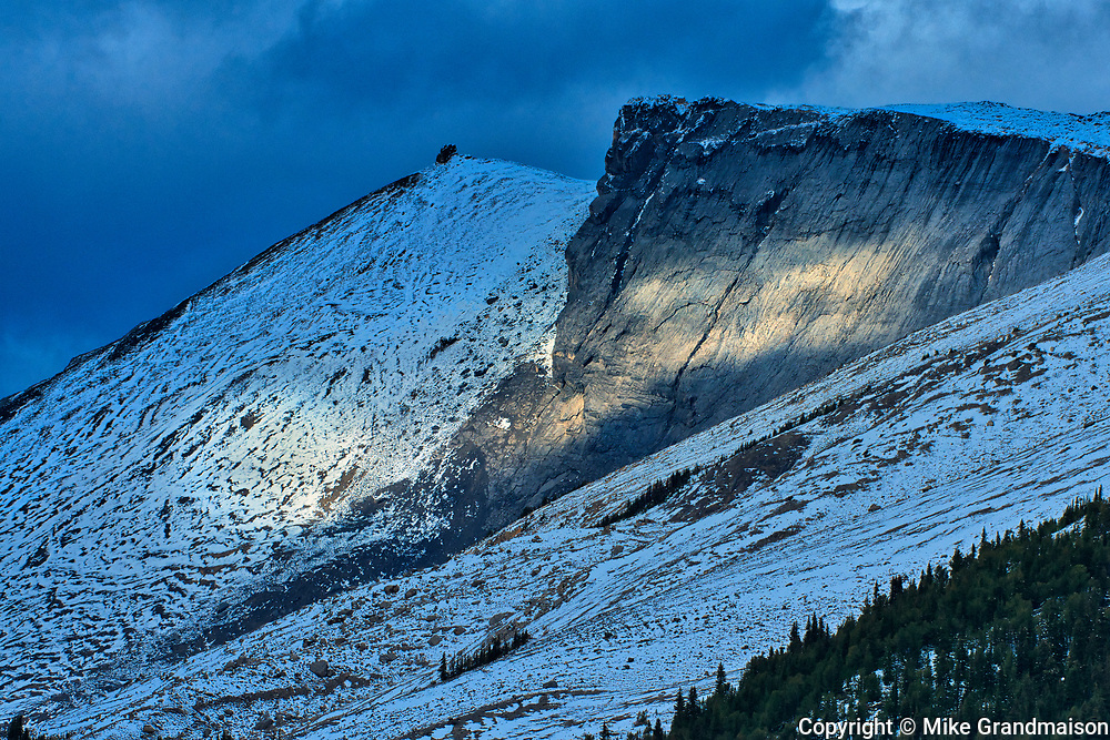 Storm light on mountain peaks near Big Bend. The Icefields Parkway.<br />Banff National Park<br />Alberta<br />Canada