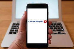 Using iPhone smartphone to display logo of Turkish Airlines