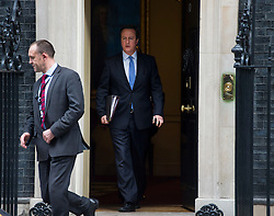 © Licensed to London News Pictures. 02/12/2015. London, UK. British prime minister DAVID CAMERON leaving 10 Downing Street in London on the day that parliament is due to debate and vote on UK military involvement in the bombing of ISIS in Syria. Photo credit: Ben Cawthra/LNP