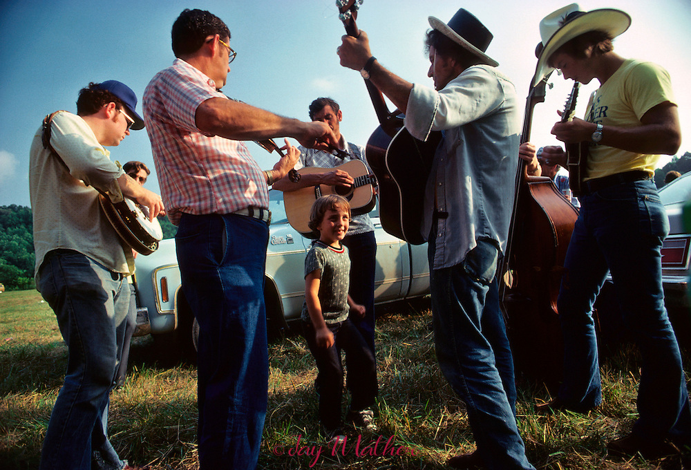 An energetic boy dances a jig during a blugrass music jam session in Renfro Valley, Kentucky.