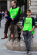 Legal observers from Liberty keep a close eye on the 'Britain Needs a Pay Rise' TUC demo, October 18th, London.