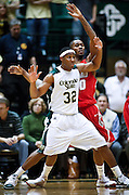 SHOT 2/23/10 10:41:14 PM - Colorado State's Andy Ogide tries to post up against New Mexico's A.J. Hardeman during the second half of their regular season Mountain West Conference game at Moby Arena in Fort Collins, Co. New Mexico survived a tight game winning 72-66. (Photo by Marc Piscotty / © 2010)