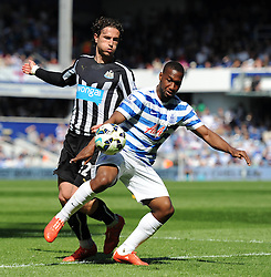 Queens Park Rangers' David Hoilett jostles for the ball with Newcastle United's Daryl Janmaat - Photo mandatory by-line: Dougie Allward/JMP - Mobile: 07966 386802 - 16/05/2015 - SPORT - football - London - Loftus Road - QPR v Newcastle United - Barclays Premier League
