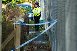 © Licensed to London News Pictures. 09/01/2020. Didcot, UK. Thames Valley Police set up a cordon including a back street path after blood was discovered on a house door, the crime scene in the Mendip Heights estate is close to where three men were injured during an incident and were taken to hospital for treatment. One of the men, aged in his forties was later pronounced dead and a murder investigation was launched. The victim received multiple stab wounds. Two other victims, one man in his twenties and another man in his thirties, are in serious but stable conditions in hospital. Photo credit: Peter Manning/LNP