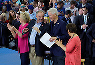 Democratic presidential nominee Hillary Clinton (L) claps as running mate Tim Kaine (2nd L) talks to her Hillary's husband Bill at a campaign kickoff rally after the Democratic National Convention in Philadelphia July 29, 2016. At right is Kaine's wife Anne Holton. REUTERS/Rick Wilking