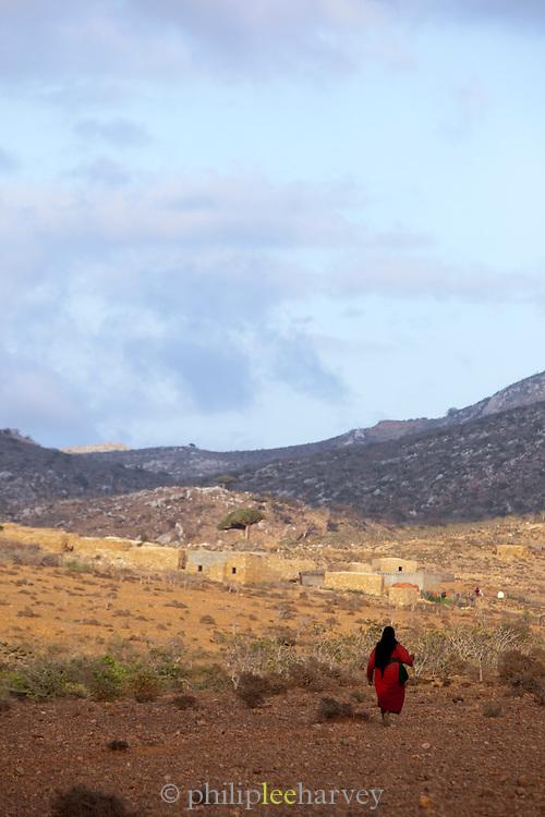 Woman walking towards a small village in Homhil, Socotra, Yemen