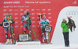 08.12.2013, Birds of Prey, Beaver Creek, USA, FIS Ski Weltcup, Beaver Creek, Riesentorlauf, Herren, Siegerpraesentation, im Bild v.l.n.r. Bode Miller (USA/2. Platz), Ted Ligety (USA/1. Platz), Marcel Hirscher (AUT/3. Platz), Anne Price (Raptor Foundation) mit Steinadler // f.l.t.r. 2nd place Bode Miller of the USA, 1st place Ted Ligety of the USA and 3rd place Marcel Hirscher of Austria and Anne Price (Raptor Foundation) with a Eagle Celebrate on Podium after mens Giant Slalom of the Beaver Creek FIS Ski Alpine World Cup at the Birds of Prey Raptor in Beaver Creek, United States on 2012/12/08. EXPA Pictures © 2013, PhotoCredit: EXPA/ Johann Groder