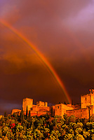 The Alhambra palace with a massive rainbow above it,  Granada, Granada Province, Andalusia, Spain.