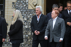 © Licensed to London News Pictures. 07/10/2014London, UK. Bruce Welch and Mike Batt leave the funeral of singer Lynsey de Paul in Hendon, North London Photo credit : Simon Jacobs/LNP