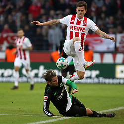 COLOGNE, Feb. 18, 2018  Oliver Sorg of Hannover and Simon Zoller (Top) of Koeln vie for the ball during the Bundesliga match between 1. FC Koeln and Hannover 96 in Cologne, Germany, on Feb. 17, 2018. The match ended with a tie 1-1. (Credit Image: © Ulrich Hufnagel/Xinhua via ZUMA Wire)