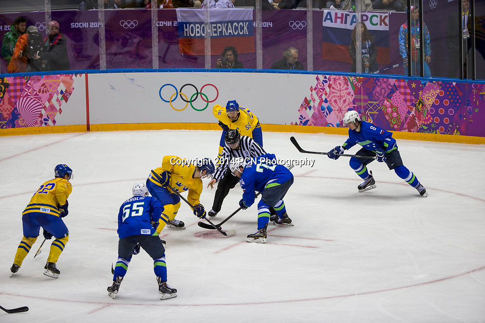 Face off during Sweden vs Slovenia game at the Olympic Winter Games, Sochi 2014