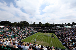 A general view of men's singles action on court 2 between John Millman and Milos Raonic on day three of the Wimbledon Championships at the All England Lawn Tennis and Croquet Club, Wimbledon.