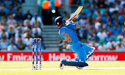 Virat Kohli (capt.) of India  twists back below a short ball