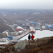 Mary Burns, left, and Kim Bell, both visiting from Toronto, take in the view of the St. John's Harbour from one of the trails on Signal Hill in St. John's, Newfoundland and Labrador, Canada, on Monday, June 3, 2019. THE BLADE/KURT STEISS <br /> MAG NewfoundlandXX
