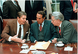 United States President Ronald Reagan, left, confers with United States Senate Majority Leader Robert Dole (Republican of Kansas), center,  and United States Senate Minority Leader Robert Byrd (Democrat of West Virginia), right, during a meeting with a bi-partisan group of Congressional Leaders in the Cabinet Room in the White House in Washington, D.C. on Friday, January 4, 1985..Mandatory Credit: Bill Fitz-Patrick - White House via CNP