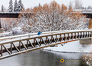 Cross Country skiing across Footbridge on the Whitefish River in Whitefish, Montana, USA model released