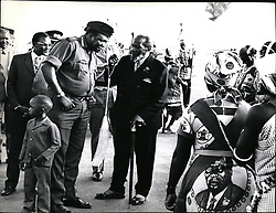 Dec. 12, 1973 - Credit: Camerapix Another Presidential visitor was General Idi Amin Dada of Uganda, seen here with President Kenyatta (and holding the hend of his small son Moses) watching traditional Kenyan dancers perform. (Credit Image: © Keystone Press Agency/Keystone USA via ZUMAPRESS.com)