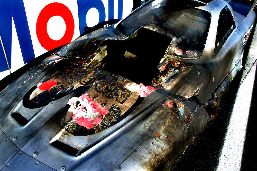 Germany, Hockenheim, 23-08-2003.<br /> Auto racing.<br /> Dragster race.<br /> A totally burned out race car.<br /> Photo: Klaas Jan van der Weij.