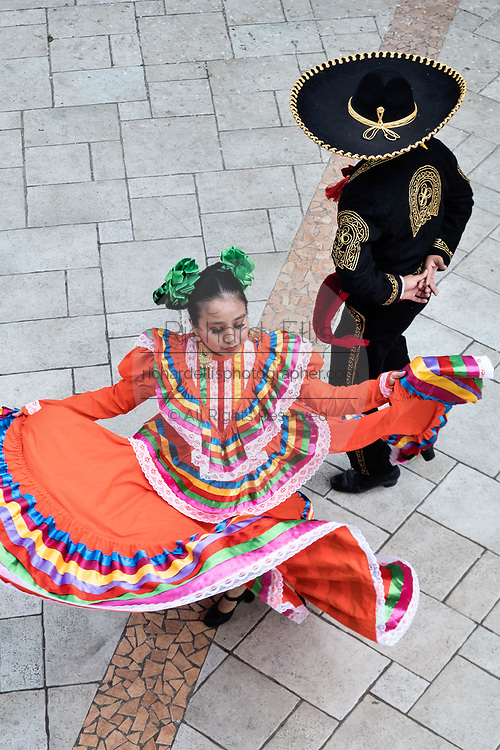 Costumed Mexican dancers perform the traditional Jarabe Tapatío folk dance in the Plaza Central Israel Tellez Park in Papantla, Veracruz, Mexico.