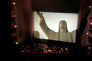 interior of movie theater with Jesus on the screen
