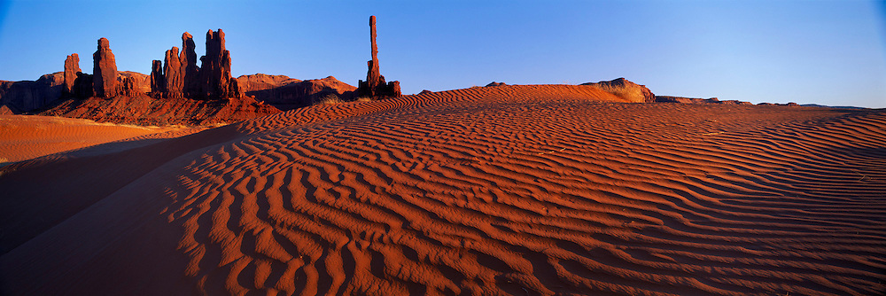 ARIZONA, MONUMENT VALLEY sand dunes at Totem Pole Rock