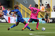 AFC Wimbledon midfielder Ossama Ashley (36) tackling Queens Park Rangers Paul Smyth (18) during the Pre-Season Friendly match between AFC Wimbledon and Queens Park Rangers at the Cherry Red Records Stadium, Kingston, England on 14 July 2018. Picture by Matthew Redman.