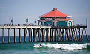 Surfing At The Huntington Beach Pier