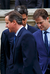 © Licensed to London News Pictures. 08/05/2015. LONDON, UK. Prime Minister David Cameron, Ed Miliband and Nick Clegg attending a service of remembrance at the Cenotaph in London marking the 70th anniversary of VE Day on Friday, 8 May 2015. Photo credit : Tolga Akmen/LNP