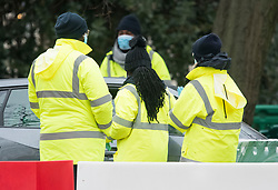 © Licensed to London News Pictures. 05/01/2021. London, UK. Workers help to administer COVID-19 tests at a temporary drive through COVID-19 test centre in Hyde Park, central London, as the UK is placed in to a third national lockdown. Photo credit: Ben Cawthra/LNP