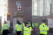 The morning after the terrorist attack at Fishmongers Hall on London Bridge, in which Usman Khan a convicted, freed terrorist killed 2 during a knife a attack, then subsequently tackled by passers-by and shot by armed police - officers guard the southern end of the bridge, on 30th November 2019, in London, England.