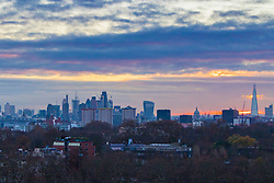 London, November 30 2017. The sun rises over the London skyline, seen from Primrose Hill, on a chilly London morning when overnight temperatures plunged to below freezing. © Paul Davey