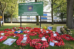 © Licensed to London News Pictures. 23/08/2013<br />  Lee Rigby flowers and a headstone outside Royal Artillery Barracks Woolwich in memory of the murdered soldier.<br /> Photo credit :Grant Falvey/LNP