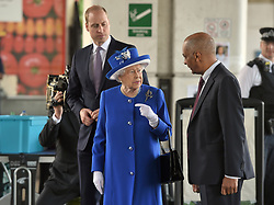 Lord Lieutenant of greater London Ken Olisa (right) greets Queen Elizabeth II and the Duke of Cambridge as they arrive to meet members of the community affected by the fire at Grenfell Tower in west London during a visit to the Westway Sports Centre which is providing temporary shelter for those who have been made homeless in the disaster.