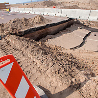 070613       Cable Hoover<br /> <br /> A section of US Highway 491 at the 44 mile marker north of Naschitti is block off by the New Mexico Department of Transportation Saturday after it was damaged by flooding Friday.